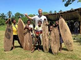 Tom with local board builders, Tupira Surf Camp, Papua New Guinea